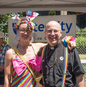 Charis with the Very Rev. Dr. Brian Baker, Dean of Trinity Cathedral, at the 2015 Sacramento Pride Festival