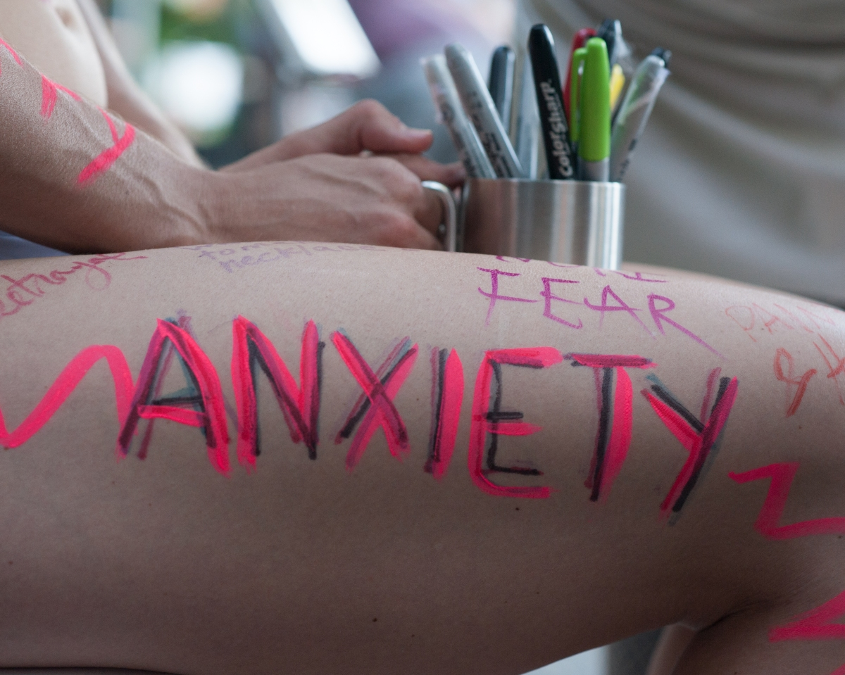 I Wore a Blindfold and Asked People to Write Their Pain on My Body. This Is What Happened.